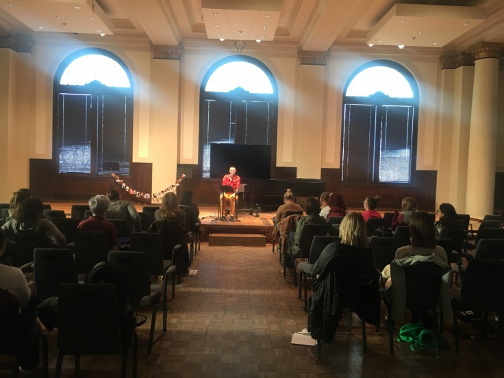 D. Allen reads at Augustana College, IA, in spring 2018. Photo by kiki kosnick.